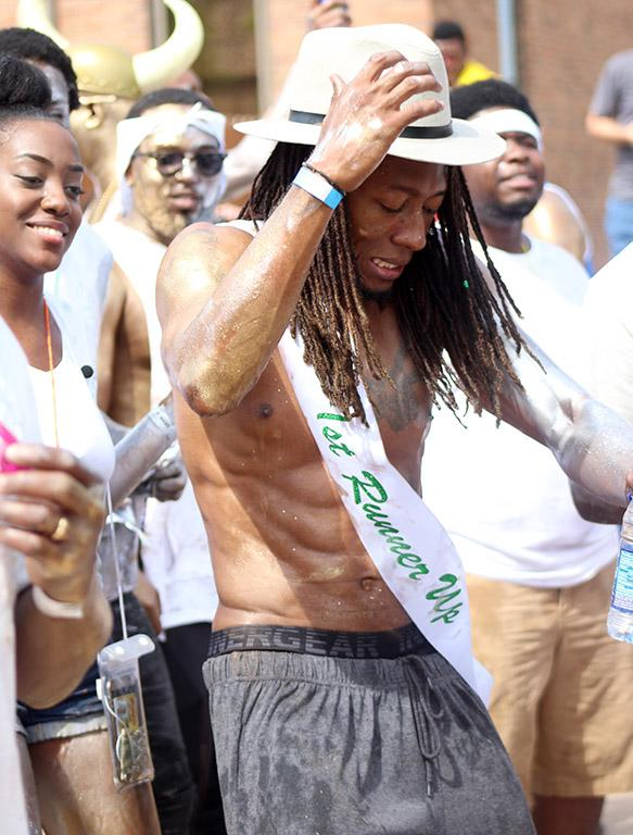 Edward Collins, Psychology freshman, dances to shows off his 1st runner up sash at the 2017 Caribfest parade held in the Dillard parking lot Sept 30. Photo by Marissa Daley