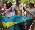 Theo Rolle, mechanical engineer junior, waves the Bahama flag during the Caribfest Parade that looped from Dillard to Jesse Rogers Promenade Sept. 30. Photo by Rachel Johnson
