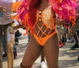 Kamilah Tobin, mass communication sophomore, dances in her bright feathered outfit during the Caribfest Parade that looped from Dillard to Jesse Rogers Promenade Sept. 30. Photo by Rachel Johnson