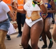 Shenice Walters, biology senior, dances and sings with other participants in the Caribfest Parade that looped from Dillard to Jesse Rogers Promenade Sept. 30. Photo by Rachel Johnson