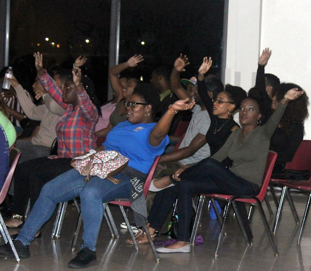 The audience waves their arms in musical harmony for the 2017 Caribfest Soca Show hosted in the Sikes Lake Center. Sept. 29. Photo by Marissa Daley