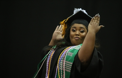Christina Breedlove jumps across stage at graduation, Dec. 16, 2017. Breedlove received her Bachelor of Science in Nursing. Photo by Bradley Wilson