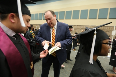 Doug Bilyeau learns how to pronounce students' names before graduation, Dec. 16, 2017. Photo by Bradley Wilson