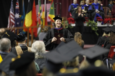 Laura Fidelie, associate professor, receives the Faculty Award during the MSU commencement ceremony at Kay Yeager Coliseum. Saturday Dec. 16, 2017. Photo by Francisco Martinez