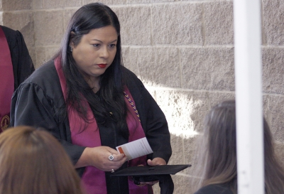 Michelle Castro, BFA graduate, gets her information card at the fall 2017 commencement at the Kay Yeager Colliseum on Sat. Dec. 16, 2017. Photo by Justin Marquart