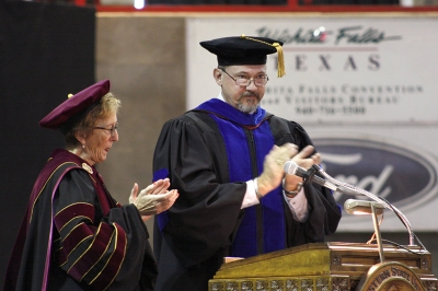 Suzanne Shipley, university president, and James Johnston, provost and vice president for academic affairs,congradulate the graduates for completeing the required courses for their degrees at the fall 2017 commencement at the Kay Yeager Colliseum on Sat. Dec. 16, 2017. Photo by Justin Marquart