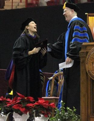 Laura Fidelie, criminal justice professor, wins the Faculty Award, which was presented by David Carlston, faculty senate chair, at the beginnning of Commencement in Kay Yeager Coliseum, Sat. Dec. 16, 2017. Photo by Rachel Johnson