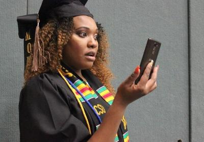 Keira Charles, finance, crys while she facetimes her mom, who was back in her home country, Dominica, moments before being taking into Kay Yeager Coliseum for Commencement, Sat. Dec. 16, 2017. Photo by Rachel Johnson