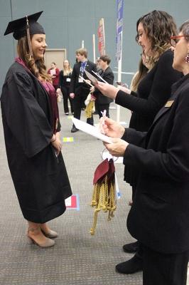 "Kylie Wright, general business, is the first graduate to get sorted and lined up in Multi-Purpose Entertainment Center for Commencement, Sat. Dec. 16, 2017. ""I'm excited, I'm ready to get out and start my next journey. I'm just going to see where God takes me,"" Wright said. Photo by Rachel Johnson"