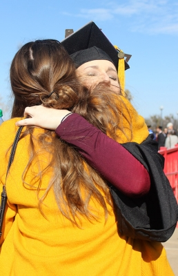 Mallory Rice, psychology, hugs Taylor Lindsay, finance junior, after leaving Kay Yeager Coliseum after the end of Commencement, Dec. 16, 2017. Photo by Rachel Johnson