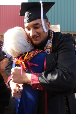 Jared Tuilagi, education, hugs one of his professors after Commencement ended outside Kay Yeager Coliseum, Dec. 16, 2017. Photo by Rachel Johnson