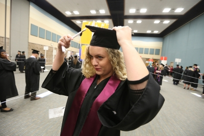 Haleigh Wallace adjusts her mortar board at graduation, Dec. 16, 2017. Photo by Bradley Wilson