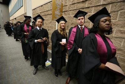 Candidates for the Master of Business Administration degree listen to announcements before graduation, Dec. 16, 2017. Photo by Bradley Wilson