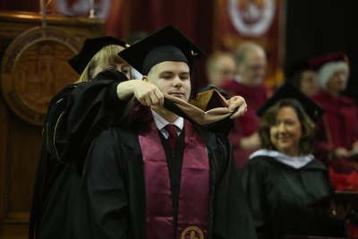 Florian Regnery received his Master of Business Administration degree at graduation, Dec. 16, 2017. Photo by Bradley Wilson