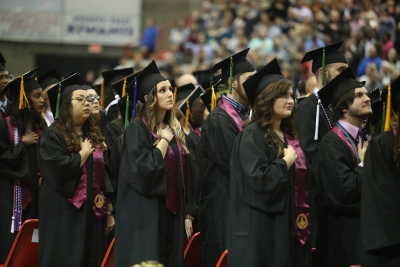 Graduating seniors sing the Star Spangled Banner at graduation, Dec. 16, 2017. Photo by Bradley Wilson