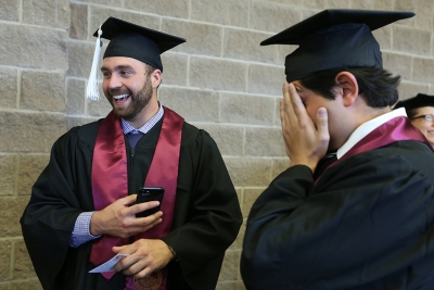 Noah Fazeks and Eddie Naidicz joke around before graduation, Dec. 16, 2017. Photo by Bradley Wilson