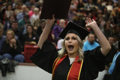 Rachel Black screams after crossing the stage at graduation, Dec. 16, 2017. Photo by Bradley Wilson
