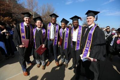 "SAE members at graduation, Dec. 16, 2017. ""They're lifelong friends, so it's bittersweet. But we'll stay in touch,"" Michael Privitt, who received his Bachelor of Business Administration degree, said. Photo by Bradley Wilson"