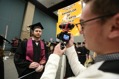 Tyler Colley talks with Sam Mitchell at graduation, Dec. 16, 2017. Photo by Bradley Wilson
