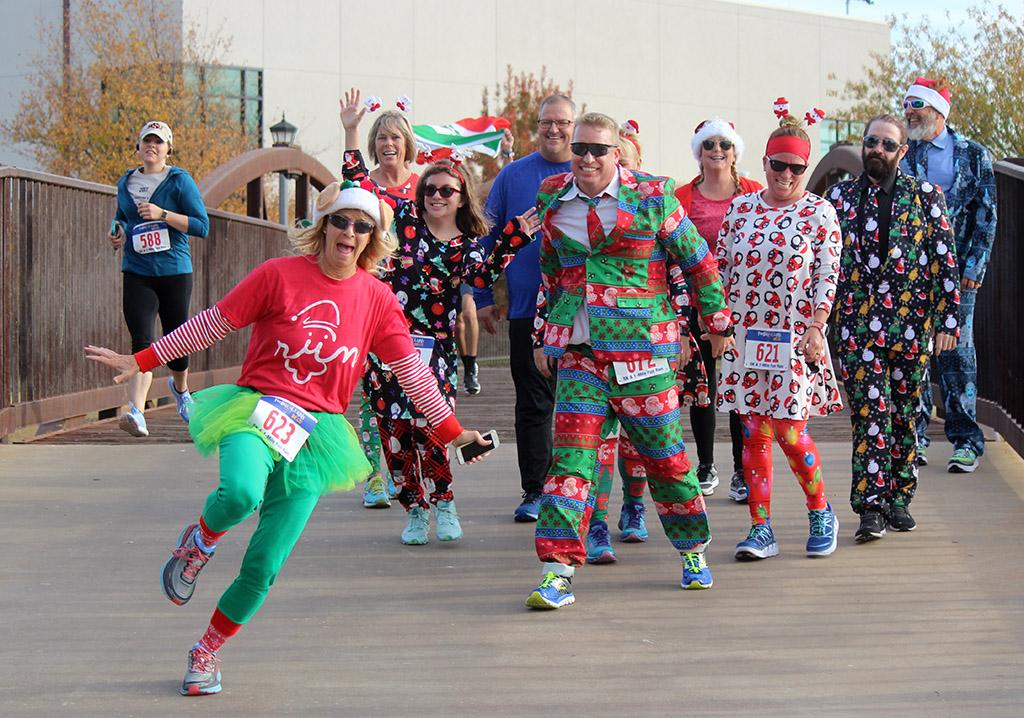 A group of participants in the Fantasy of Lights 5k who dressed up for the best and worst costume contest, which they announced the winners before the race out side the Wichita Falls Museum of Arts, Dec. 2, 2017. Photo by Rachel Johnson