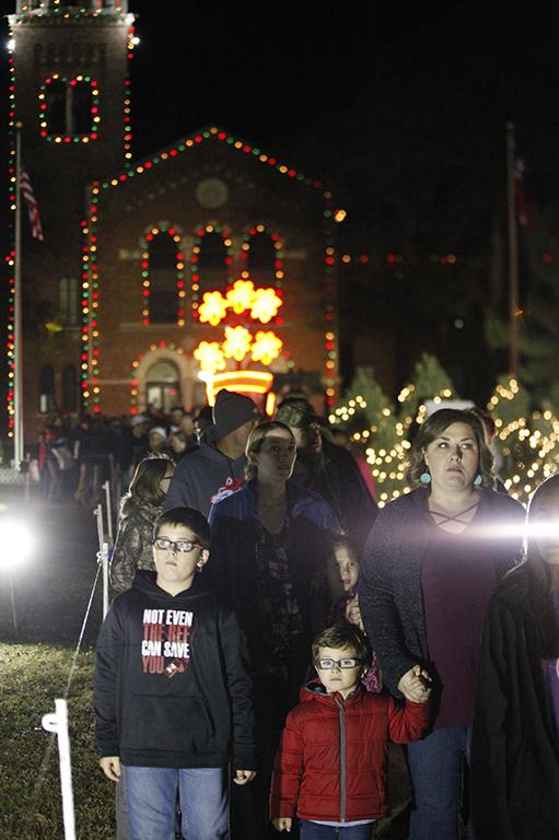 Attendees walk around looking at the displays during the MSU Burns Fantasy of Lights Opening Night at Akin Auditorium, Monday, Nov. 20, 2017. Photo by Francisco Martinez