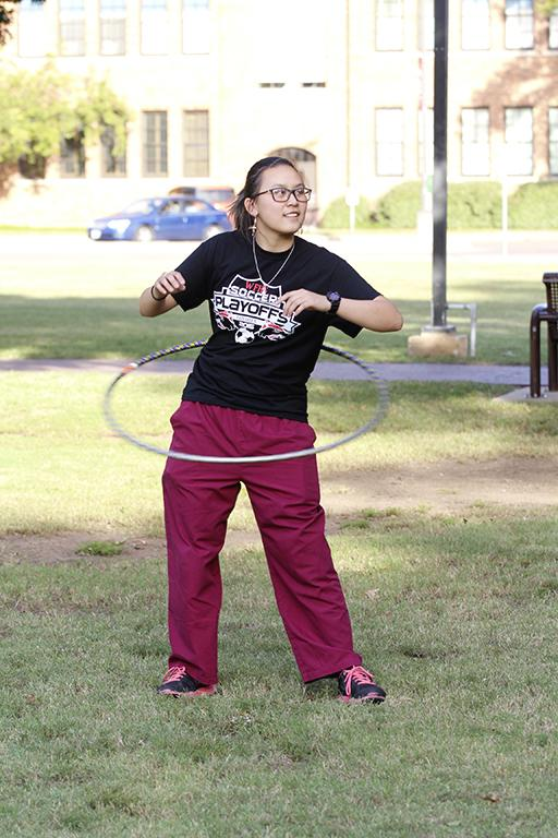 Dalena Pham, radiology junior, hoolahoops on the quad hoping to have fun and relieve some stress at the homecoming field day competitions on Oct 18, 2017. Photo by Sara Keeling