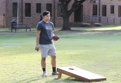 Johnny Dang, pre med sophomore, analyzes his cornhole shot at the homecoming field day competitions on Oct 18, 2017. Photo by Sara Keeling