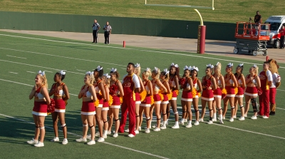 Cheerleaders stand and put their hand over their hearts during the Star Spangled Banner at the homecoming game on Saturday, Oct. 21, 2017. Photo by Shea James