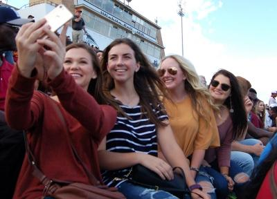Allie Camp, undecided freshman, Maddie Bradberry, english freshman, Marley Eller, biology freshman, Caycee Griffin, biology freshman, take a seflie at the homecoming game on Saturday, Oct. 21, 2017. Photo by Shea James