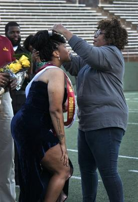 Jaylon Williams, sociology senior, is crowned the 2017 Homecoming Queen during Halftime at Memorial Stadium Saturday Oct. 21, 2017. Photo by Rachel Johnson