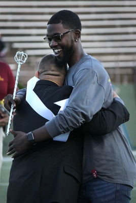 Juan Mercado, sociology senior, hugs his friend and the 2016 Homecoming Kind Charles Frazier, 2016 graduate, after finding out that Mercado was the 2017 Homecoming King. Photo by Rachel Johnson