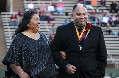 Juan Mercado, sociology senior, and his mom react to his name being called for 2017 Homecoming King, Saturday Oct. 21, 2017. Photo by Rachel Johnson