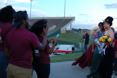 Jaylon Williams, sociology senior, takes pictures with her friends and family before after being announced Homecoming Queen on Oct. 17, 2017. photo by Shea James