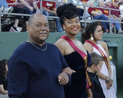 Dierrica Smith, mass communication senior, stands on the side lines with her father Gary Smith as they wait for the anncoument of Homecoming King and Queen. Sat, Oct 21, 2017. Photo by Sara Keeling