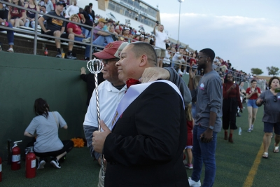 Juan Mercado, sociology senior , stands proudly for photos with Leroy McIlhaney after winning the title of King at the Homecoming game, Saturday Oct. 20, 2017. Photo by Sara Keeling