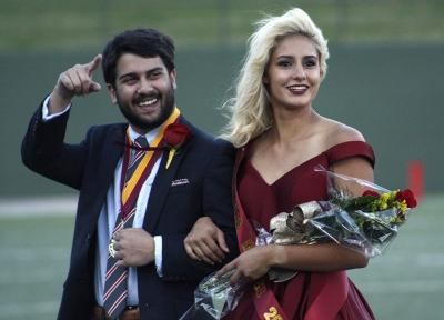Imran Kurani, political science sophomore, and Lauren Gardner, pre med sophomore, the duke and duchess on the field during halftime of the homecoming game against West Texas where the Mustangs won 45-3 at Memorial stadium on Saturday, Oct. 21, 2017. Photo by Justin Marquart