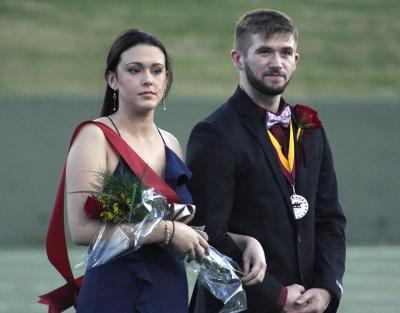 Sarah Wood, marketing junior, and Jeffrey Hamon, exercise physiology junior, the prince and princess on the field during halftime of the homecoming game against West Texas where the Mustangs won 45-3 at Memorial stadium on Saturday, Oct. 21, 2017. Photo by Justin Marquart