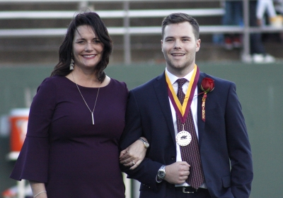 Judy Leveridge escorts her son Austin Leveridge, finance senior, during halftime of the homecoming game against West Texas where the Mustangs won 45-3 at Memorial stadium on Saturday, Oct. 21, 2017. Photo by Justin Marquart