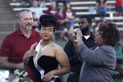 Jaylon Williams, sociology senior, crowned queen during halftime of the homecoming game against West Texas where the Mustangs won 45-3 at Memorial stadium on Saturday, Oct. 21, 2017. Photo by Justin Marquart