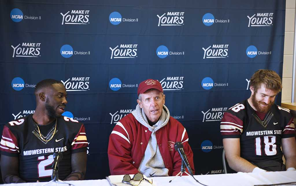 Safety and criminal justice junior Sir'Vell Ford, head coach Bill Maskill, and quarterback accounting junior Layton Rabb, at the press conference after the first game of the NCAA Division II playoff, where they beat University of Sioux Falls 24-20. Nov 18. Photo by Bridget Reilly
