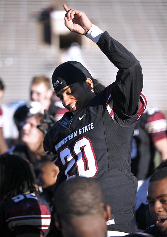 Corner back sophomore Kevin Hayes points to the sky in celebration after beating University of Sioux Falls 24-20 in the first game of the NCAA Division II play offs. Nov 18. Photo by Bridget Reilly
