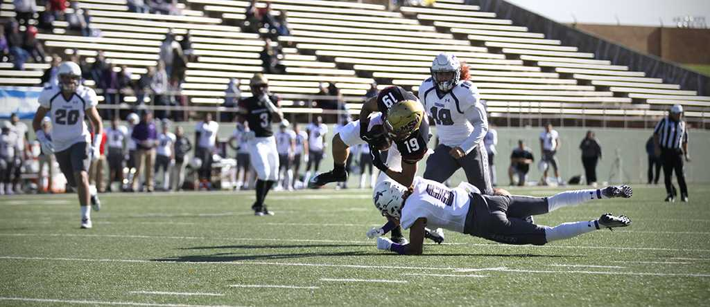Wide receiver and psychology senior D.J. Myers is tackled after a 19 yard run in the NCAA Divison II first round playoffs, against University of Sioux Falls. Nov 18. Photo by Bridget Reilly