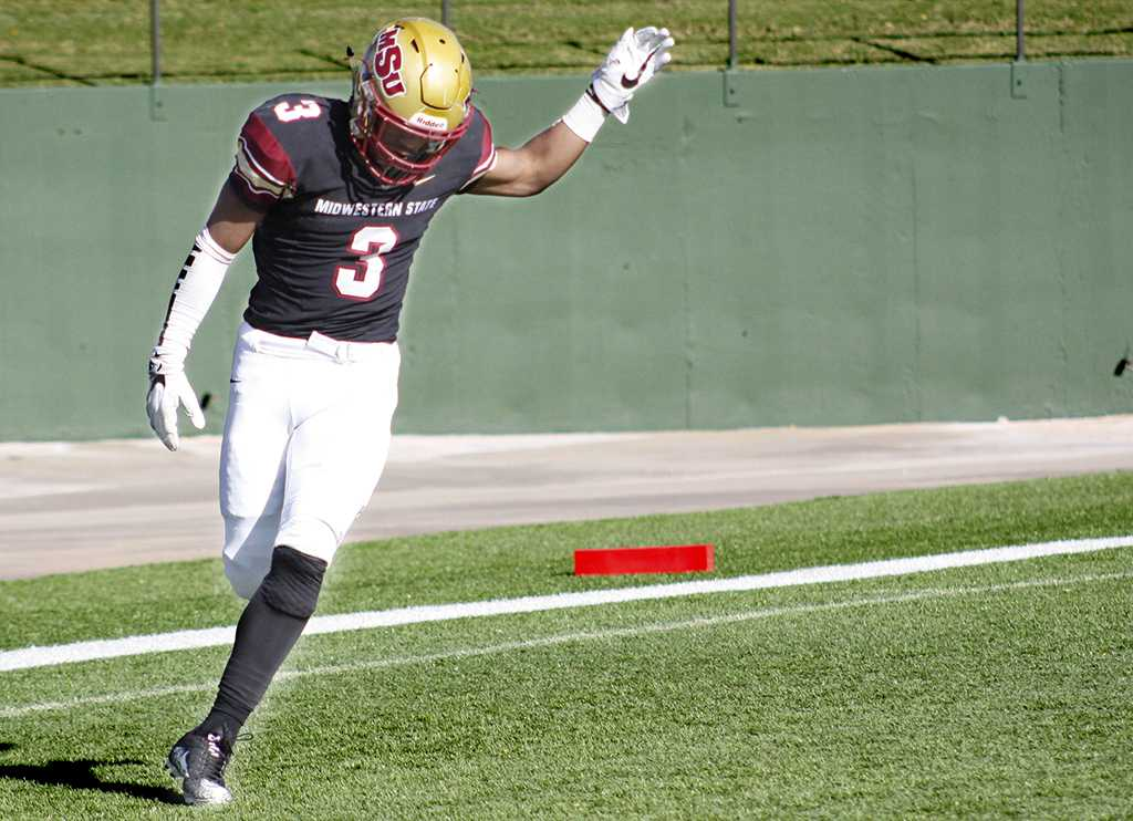Wide receiver Tyrique Edwards, criminal justice sophomore, raises his hand after scoring the second touchdown during the NCAA II playoffs first round football game against sioux falls at Memorial Stadium on Sat. Nov. 18, 2017. Photo by Justin Marquart