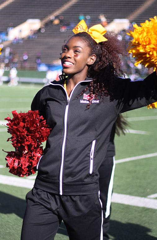 Cheerleading Captain Markiela Benoit, dental hygiene senior, cheers the MSU Football team during the Round One NCAA II Playoff game against University of Sioux Falls at Memorial Stadium, Saturday Nov. 18, 2017. MSU beat USF 24-20. Photo by Rachel Johnson