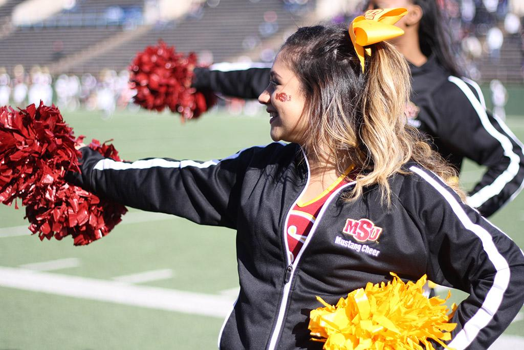 Alexia Vidaurre, pre-med freshmam, cheers on the MSU football team against University of Sioux Falls during the second quarter of the NCAA II Round One Playoffs game at Memorial Stadium. MSU beat USF 24-20. Photo by Rachel Johnson