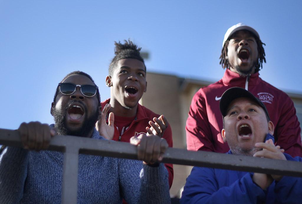 Alonzo Burris, exercise physiology senior, Jacoby Thomas, accounting freshman, Justin Harper, education sophomore, and Juan Mercado, sociology senior, cheer on the MSU football team at the NCAA II Round One Playoffs game against University of Sioux Falls at Memorial Stadium. Photo by Rachel Johnson