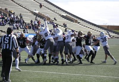 After a successful touchdown by wide reciever and criminal justice sophomore Xavier Land, kicker/punter and sports and leisure sophomore Jaron Imbriani kicks a goal against University of Sioux Falls in the first game of the NCAA Divison II playoffs. Nov 18. Photo by Bridget Reilly