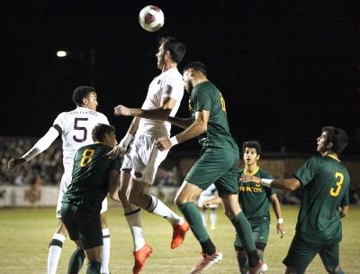 Forward and psychology senior Scott Doney defends a corner kick by Cal Poly Pomona with a header to the center field. Nov 18. Photo by Bridget Reilly