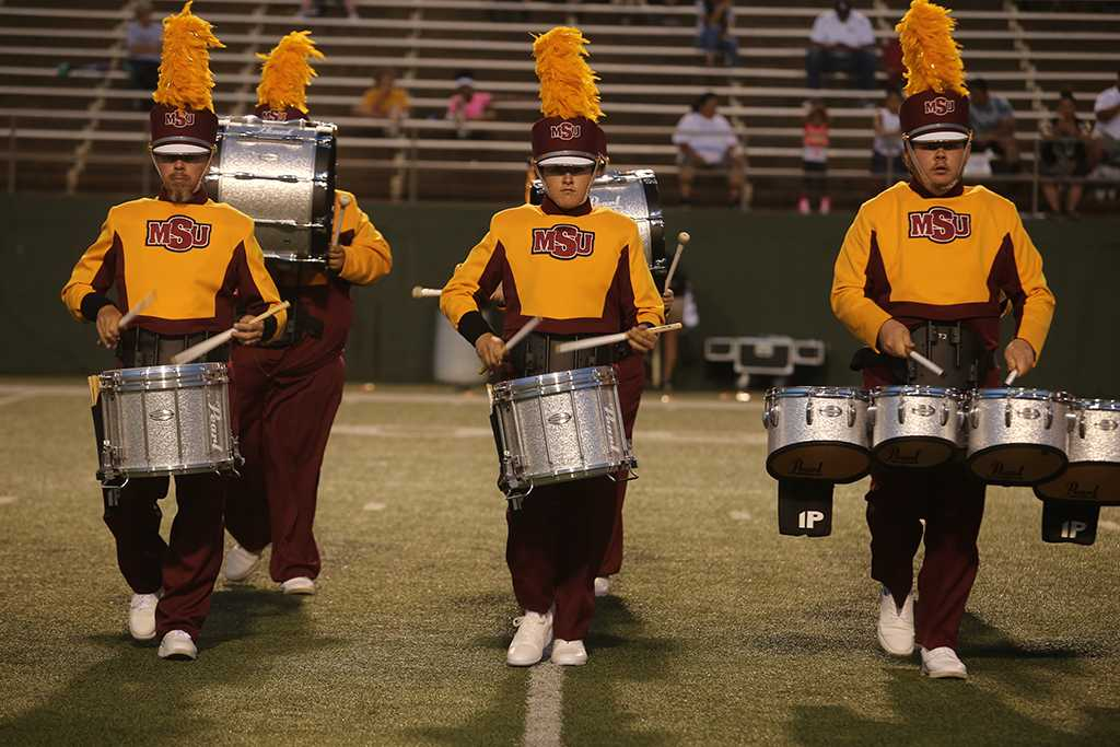 Percussionists Mike Brenmark, Chris Ward and Collin Harrison perform at the Midwestern State football game, Aug. 31, 2017, against Quincy, Illinois. MWSU won 53-6 in the season opener. Photo by Bradley Wilson