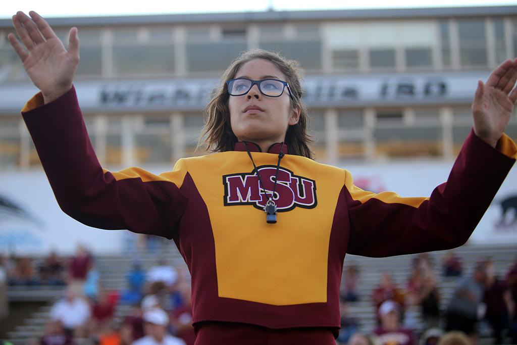 Drum major Desire Graves, music sophomore, directs the band at the Midwestern State football game, Aug. 31, 2017, against Quincy, Illinois. MWSU won 53-6 in the season opener. Photo by Bradley Wilson